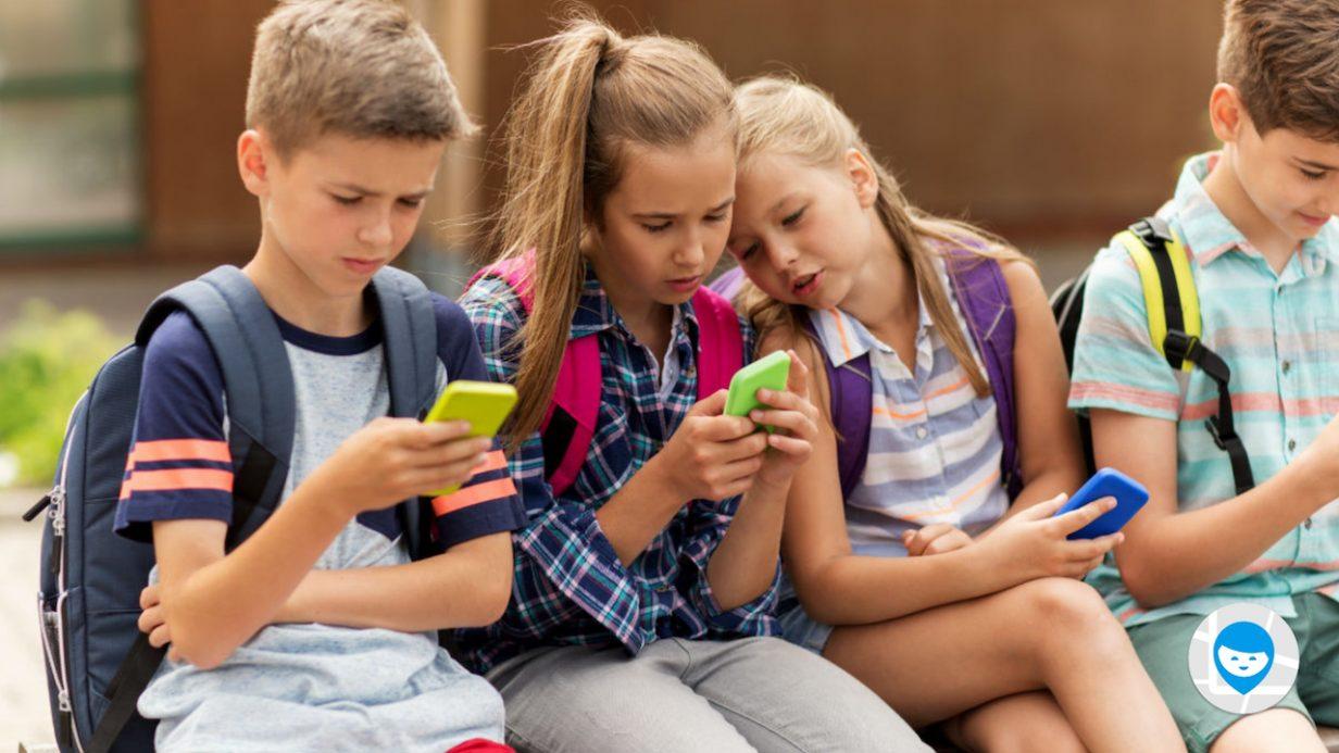 kids sit with phones